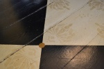 Hand-stenciled floors in the dining room.  I love the golden dot detail.