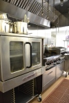 But wait, there's more!  Yup, that's a full-on commercial kitchen (in addition to a conventional residential one) .